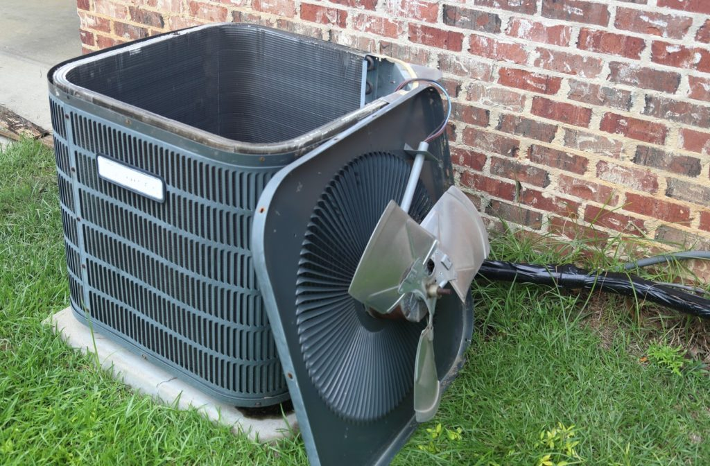 Air conditioning unit with the top removed ready to have air conditioner coils cleaned